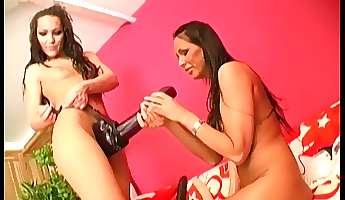 Drilling each other with big toys makes two lesbians moan loudly