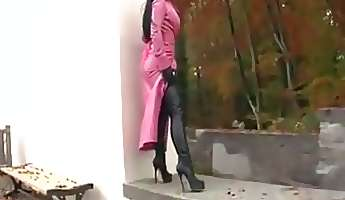 Hot brunette poses on street in latex boots