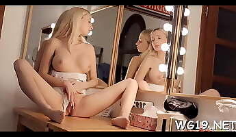 Enticing lady Nancey slowly taking off her clothes